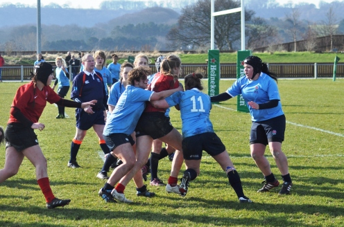 ZOE (CENTRE IN RED) ON THE CHARGE FOR THE NORTH VERSUS MIDLANDS