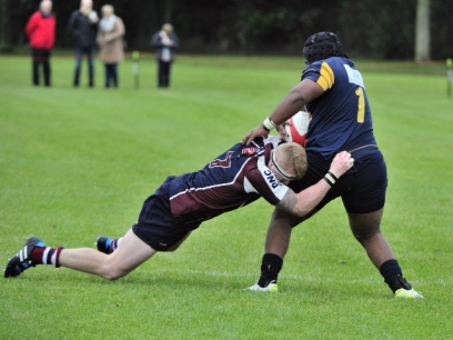 EAMON CHAPMAN TACKLES BRID PROP DAKA IN SCARBOROUGH'S 24-16 WIN AT DUKES PARK