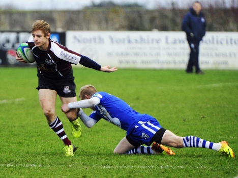 COREY DENNIS BREAKS A TACKLE AGAINST PONTEFRACT LAST WEEK photograph ANDY STANDING