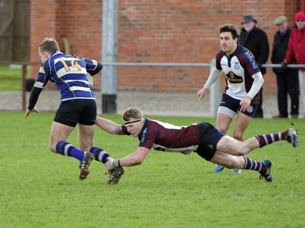 EAMON CHAPMAN tackles Yarnbury right wing PHOTO ANDY STANDING