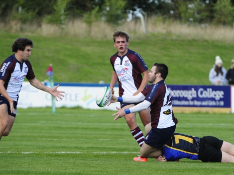 HARRY DOMETT OFFLOADS TO TOM HARRISN FOR HIS TRY Photograph ANDY STANDING